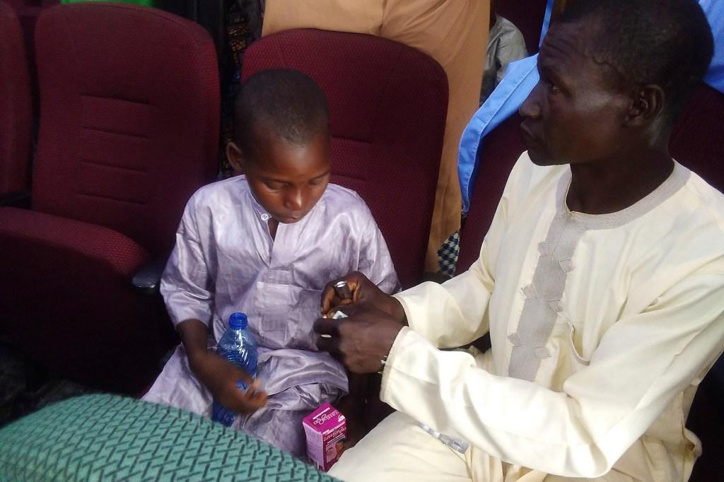 a freed student of the Salihu Tanko Islamic School, reunited with his father in Minna, Nigeria