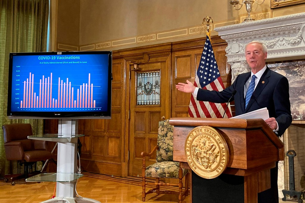 Arkansas Gov. Asa Hutchinson talks about COVID-19 vaccinations at the state Capitol in Little Rock, Ark.