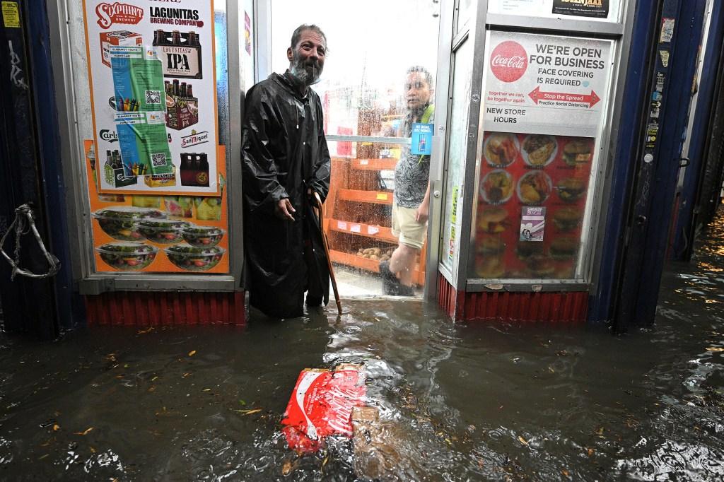 Flooding outside a bodega.