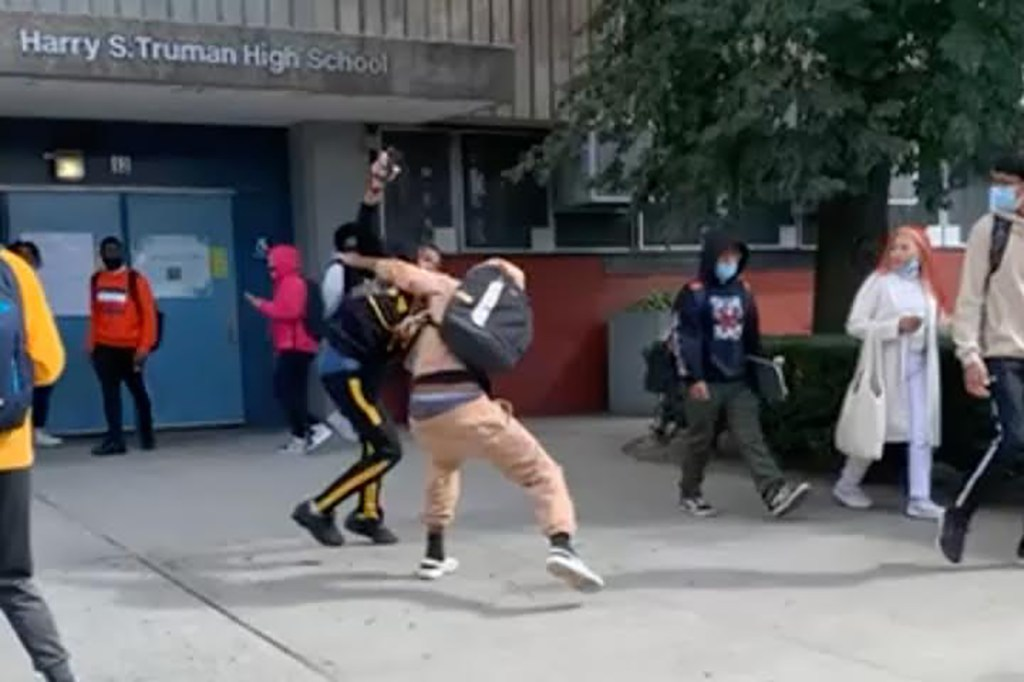 Footage shows the alleged 15-year-old teenager stabbing a student outside Harry S. Truman High School in the Bronx.