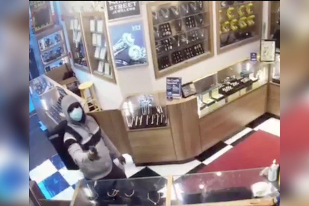 The thief fired a gun upon entry to the jewelry store.