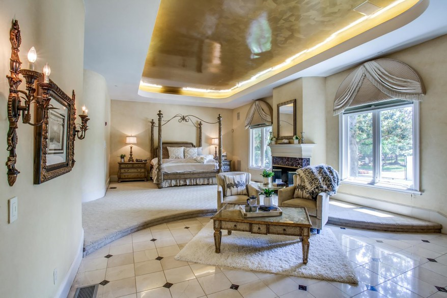 This primary bedroom suite has a sitting area, steam room, jacuzzi bath, dual bathrooms, three closets, multi-jet shower system and barrel vaulted ceilings.