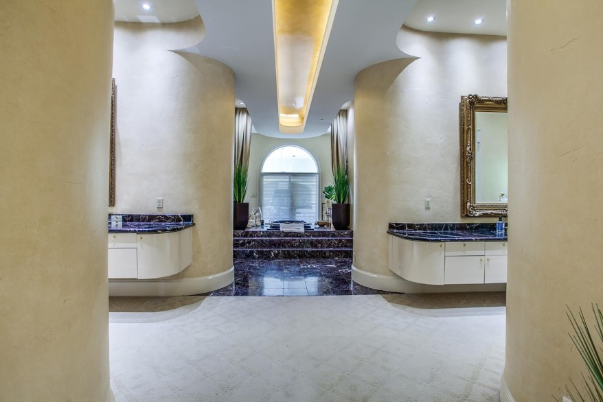A luxurious bathroom is pictured from another angle.