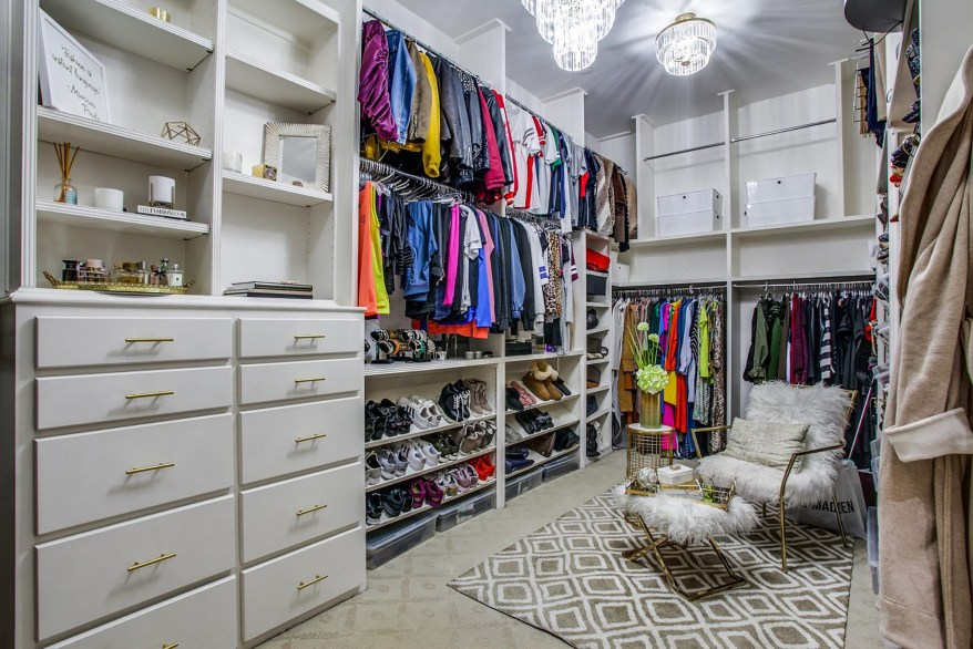 One of three walk-in closets in the primary bedroom suite is pictured.