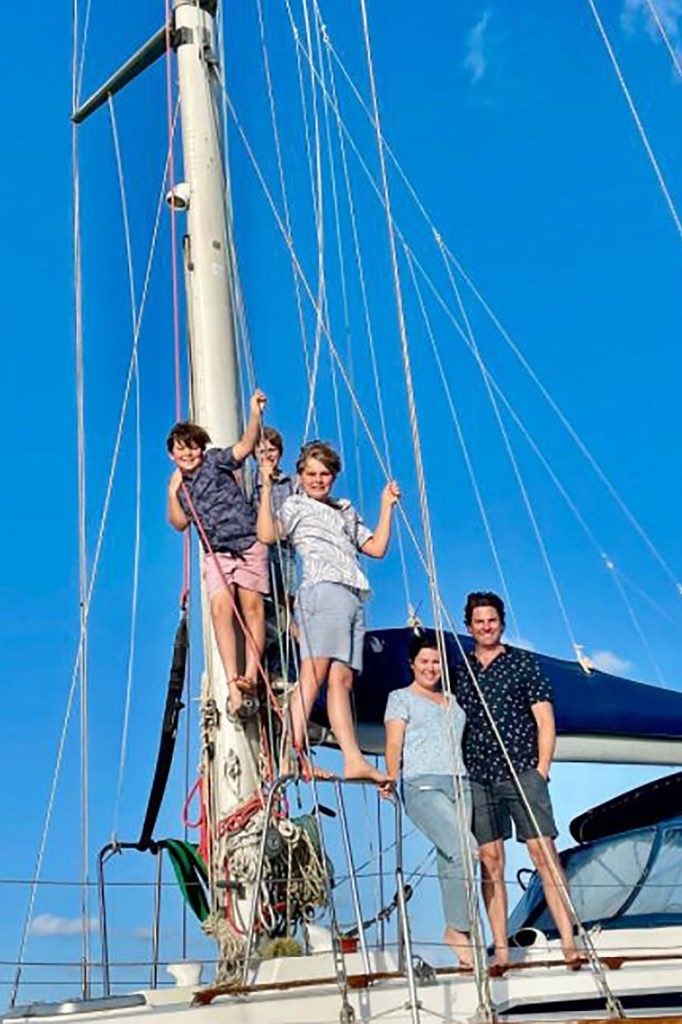 Erin Carey with her husband Dave and their three children enjoying life on a boat.