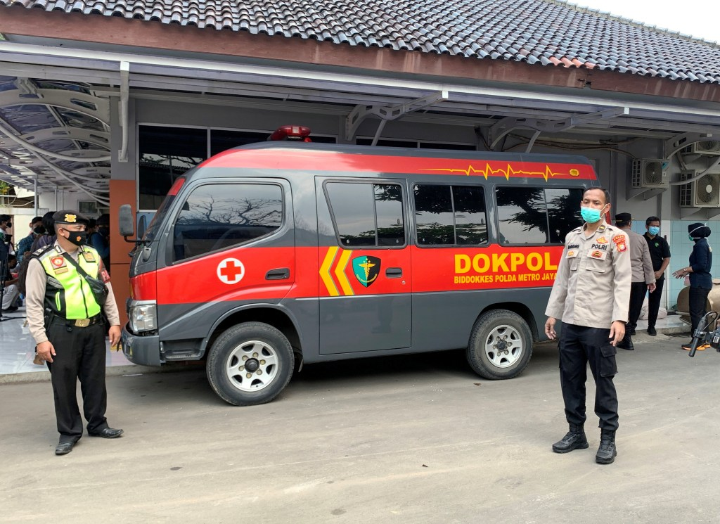 A police vehicle is seen outside Tangerang Hospital, where the remains of people killed in a fire at Tangerang Prison are kept.
