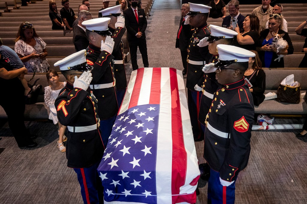 Marines salute the coffin of Lance Cpl. Kareem Nikoui following the ceremony on Sept. 18, 2021.