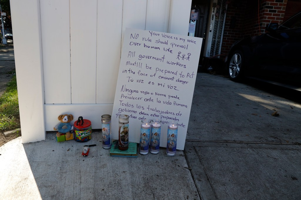 The makeshift memorial left in Queens for the lives lost.