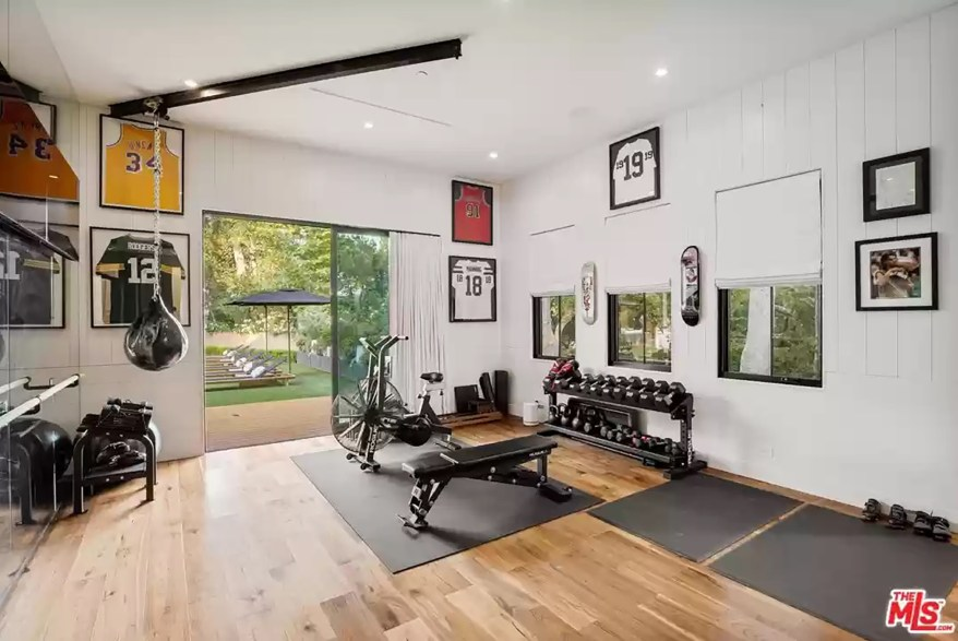 A gym in the LA house is pictured.