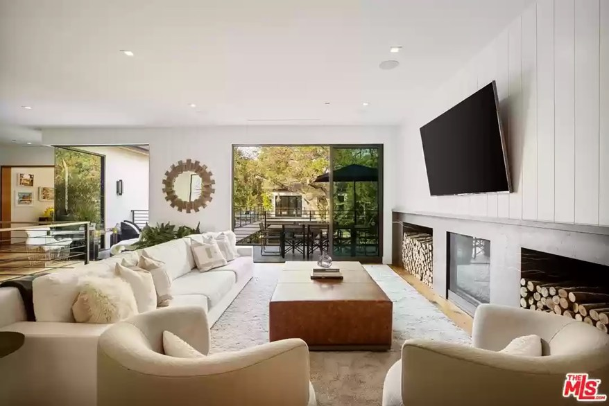 A living room in the LA house is pictured.