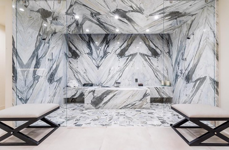 A bathroom made up of black and white marble.