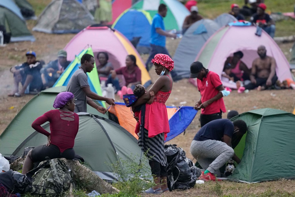 Migrants rest at a camp in Acandi, Colombia, Tuesday, Sept. 14, 2021.