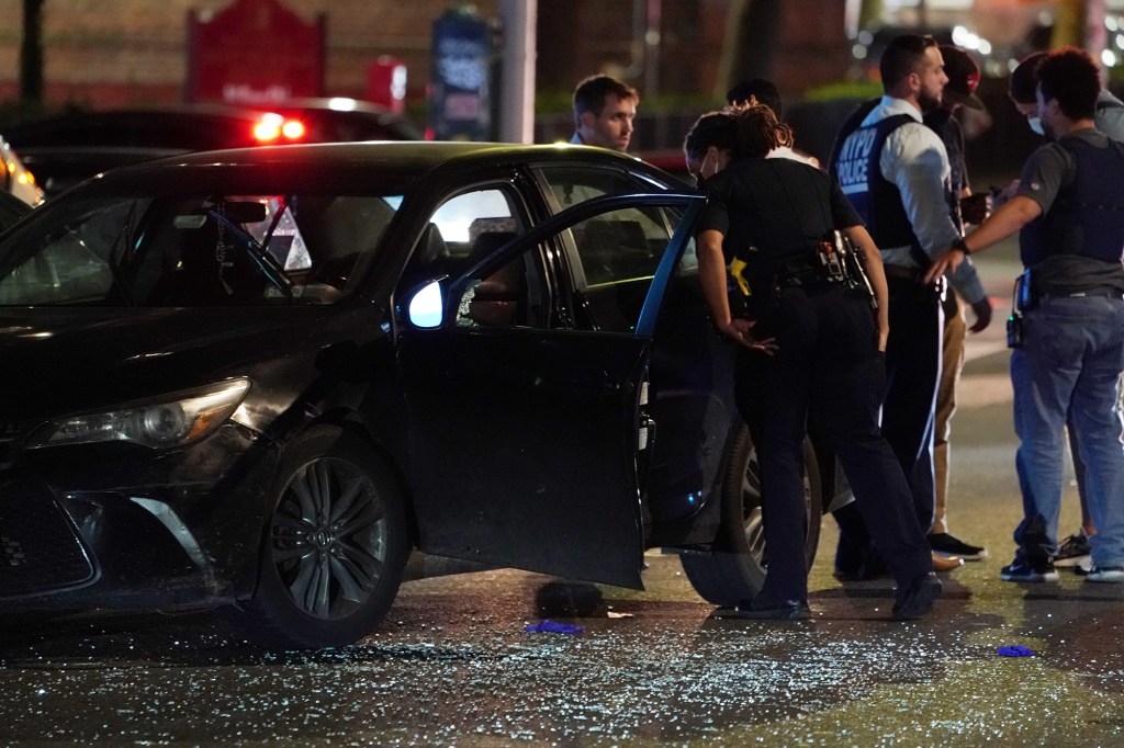 Police at the scene where two people were shot on Frederick Douglass Boulevard at W131st Street in New York, NY around 10 p.m. on September 4, 2021.
