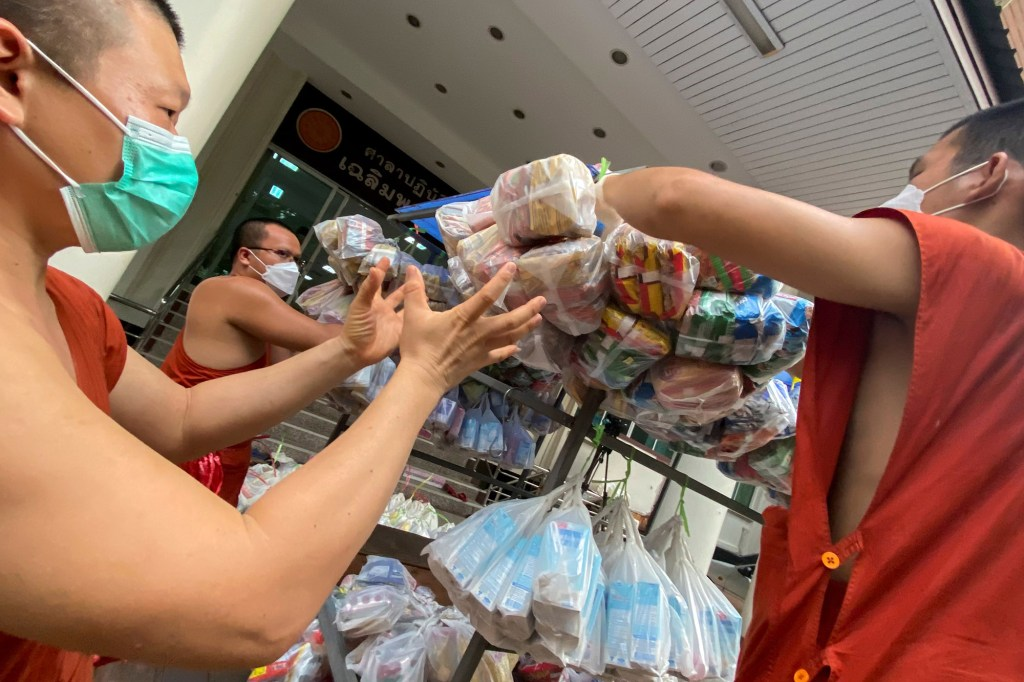 Buddhist monks from Wat Siriphong Thamma Nimit temple load food and other necessities in preparation to donate to vulnerable people whose livelihoods have been hit hard by the coronavirus disease (COVID-19) pandemic on the outskirts of Bangkok, Thailand, September 18, 2021.