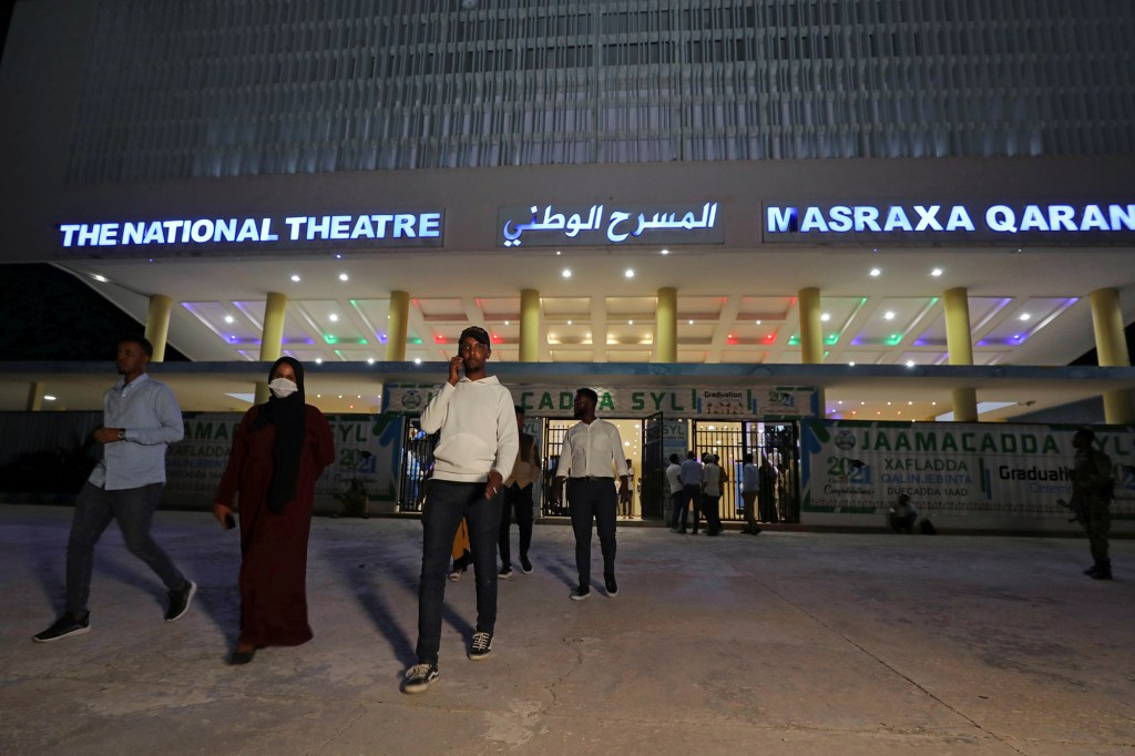Locals leave after watching the first ever film festival held at the newly rebuilt National Theater, in the capital of Mogadishu, Somalia, September 22, 2021.