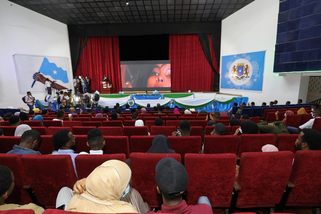Somali people watch the first ever film festival held at the newly rebuilt National Theater in the capital of Mogadishu, Somalia, September 22, 2021.