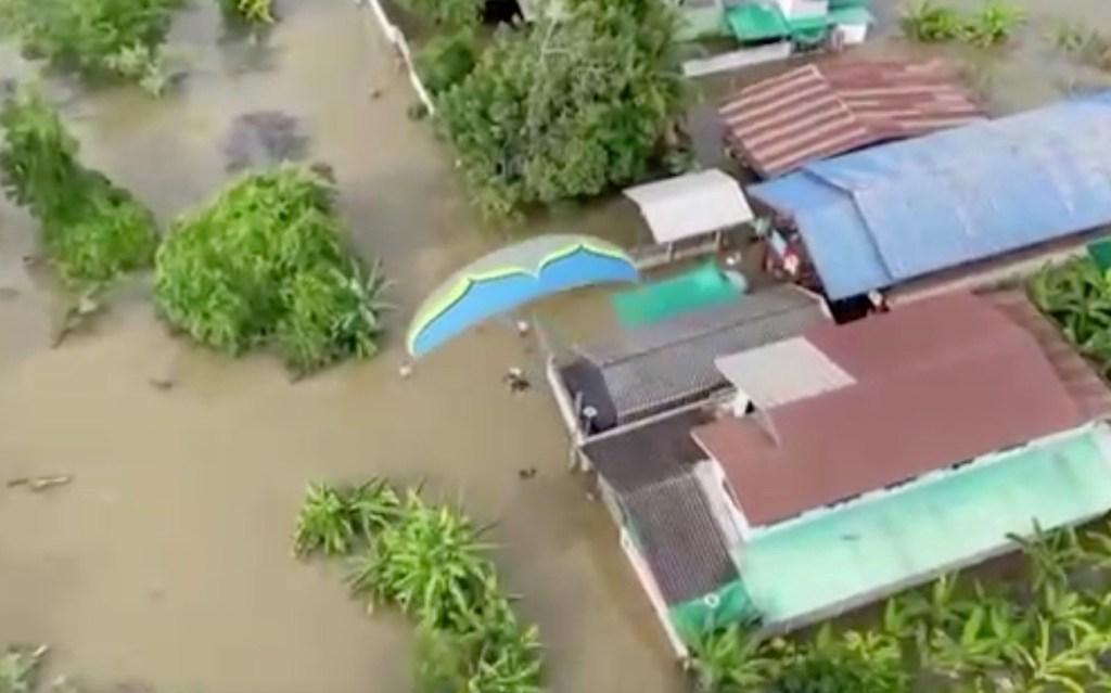 Thrill-seeker Vichai Tiyasan, 38, has been motoring over waterlogged lands to drop off dry food and essential items in Sukhothai, one of 30 provinces impacted by floods in the past week.