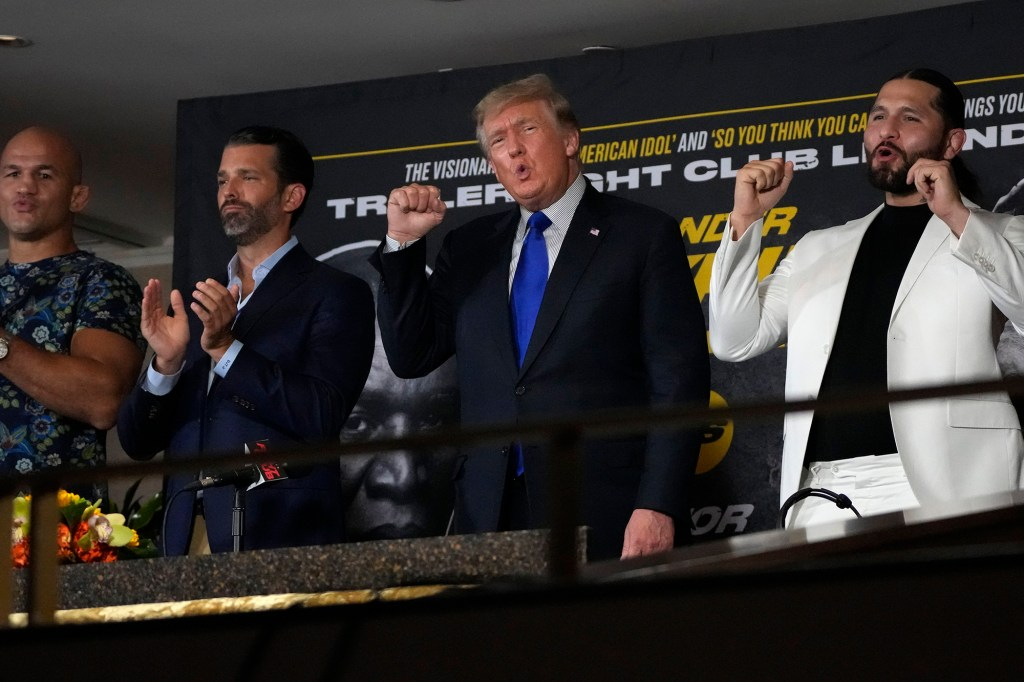"""Former President Donald Trump chants """"USA, USA"""" along with the crowd at the Hard Rock Hotel & Casino in Hollywood, Fla."""