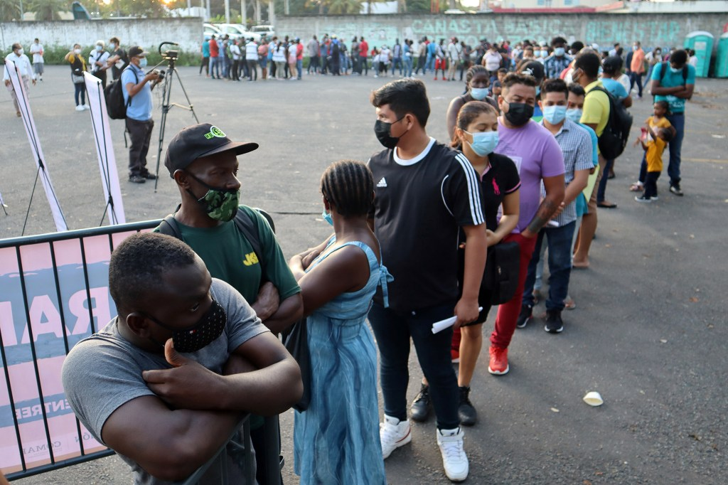 Migrants wait for asylum processing.