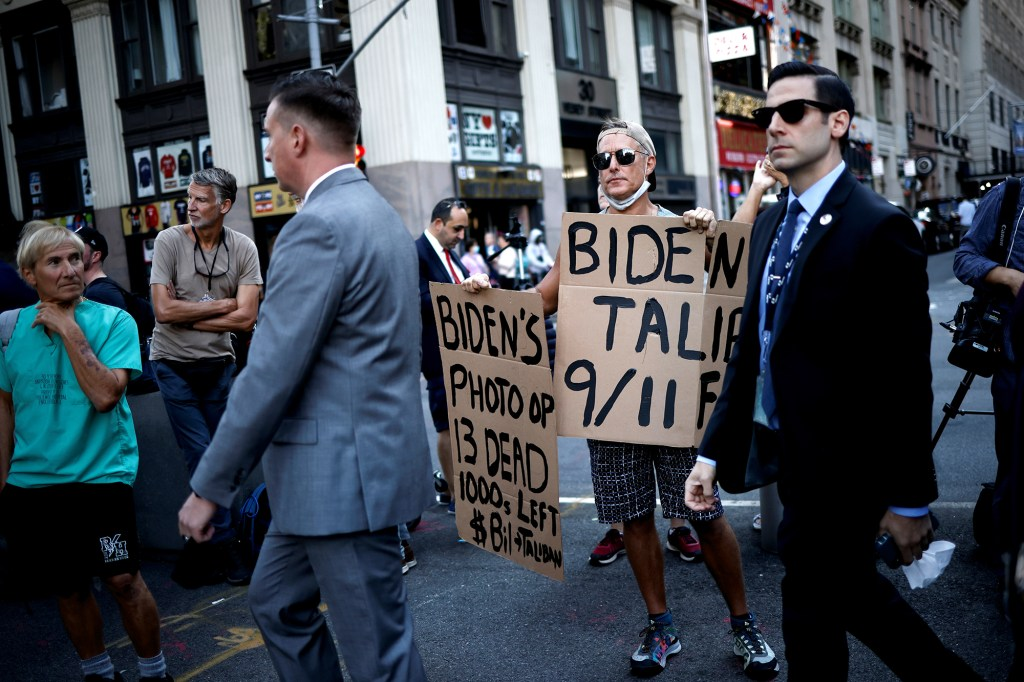 A man protests against President Joe Biden during the 20th anniversary of the September 11.