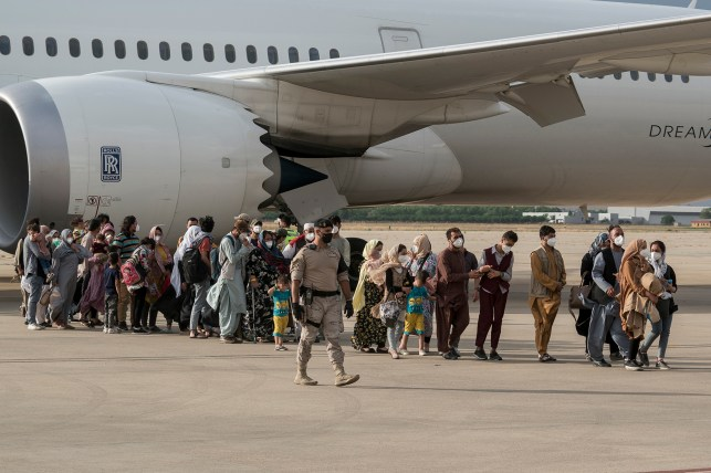Many people, including children, arrived at Torrijan de Ordos Air Base from Afghanistan on August 23, 2021 in Madrid, Spain.  Since the country came under Taliban control, a total of seven planes have departed from Kabul Airport for Torizan Base with Afghan evacuations from Spain.  Spain has managed to evacuate 566 Afghans, half of whom have applied for asylum in Spain and 91 have already been transferred to reception centers.