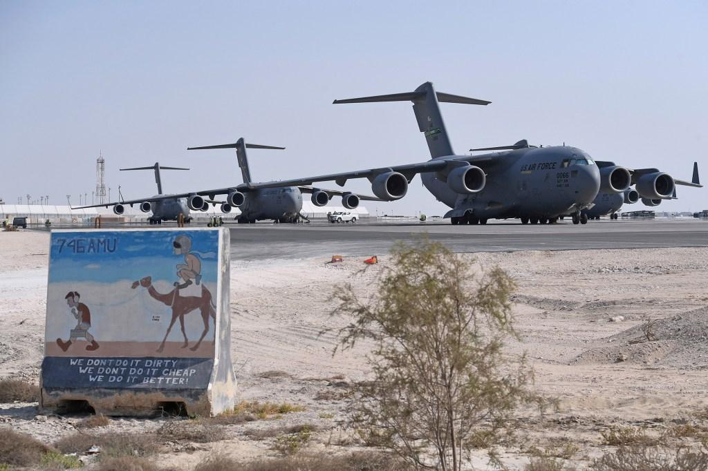 US Air Force C-17 Globemaster aircrafts sit at al-Udeid Air Base in Doha, Qatar.