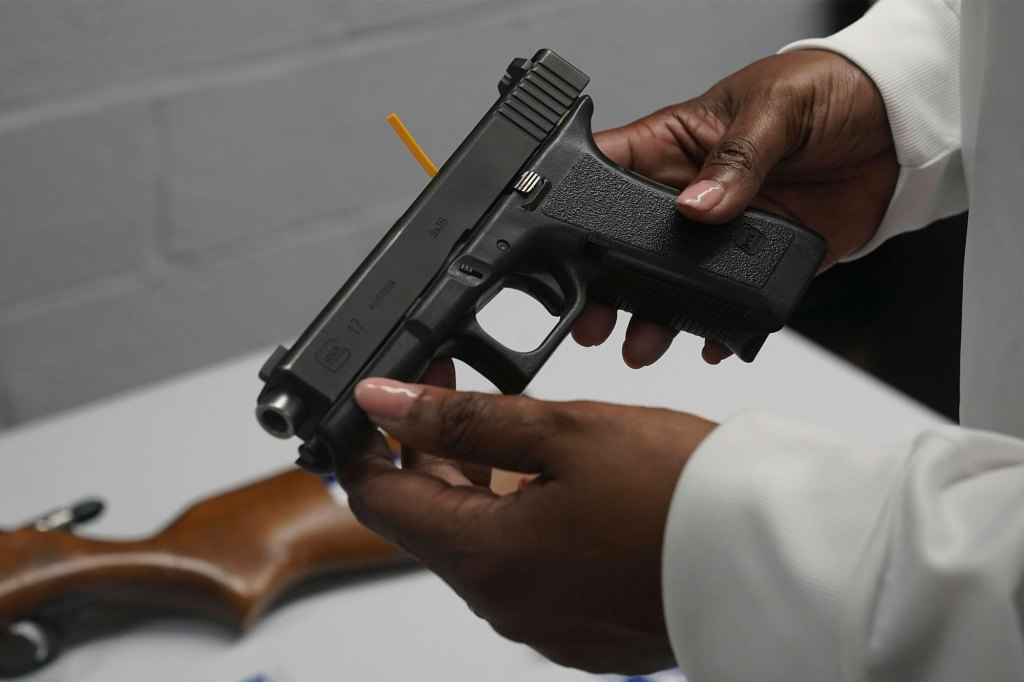 handgun from a collection of illegal guns is reviewed during a gun buyback event in Brooklyn, N.Y.