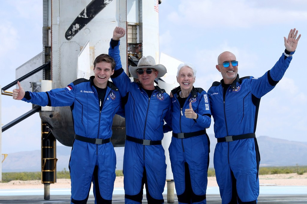 Jeff Bezos (second from left) with the other three crew members of his Blue Origin New Shepard space rocket