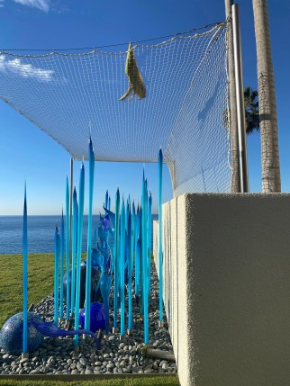 Gross and Towfiq are currently arguing over the netting surrounding a glass sculpture.