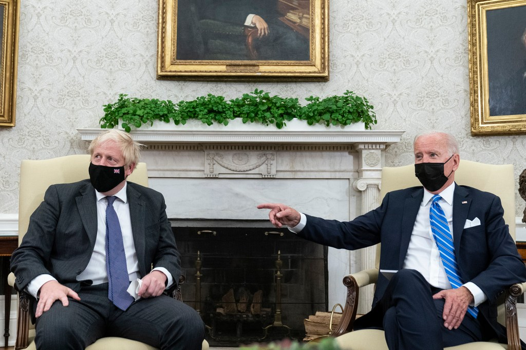 President Joe Biden, right, speaks during a meeting with British Prime Minister Boris Johnson in the Oval Office of the White House, Tuesday, Sept. 21, 2021
