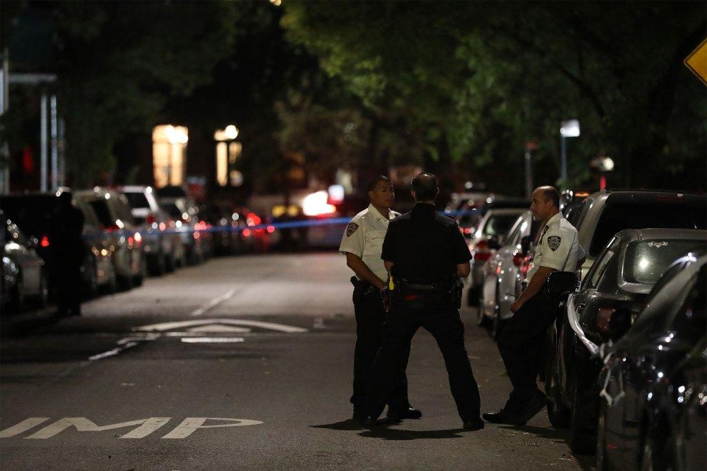 Police at the scene on Monroe Street.