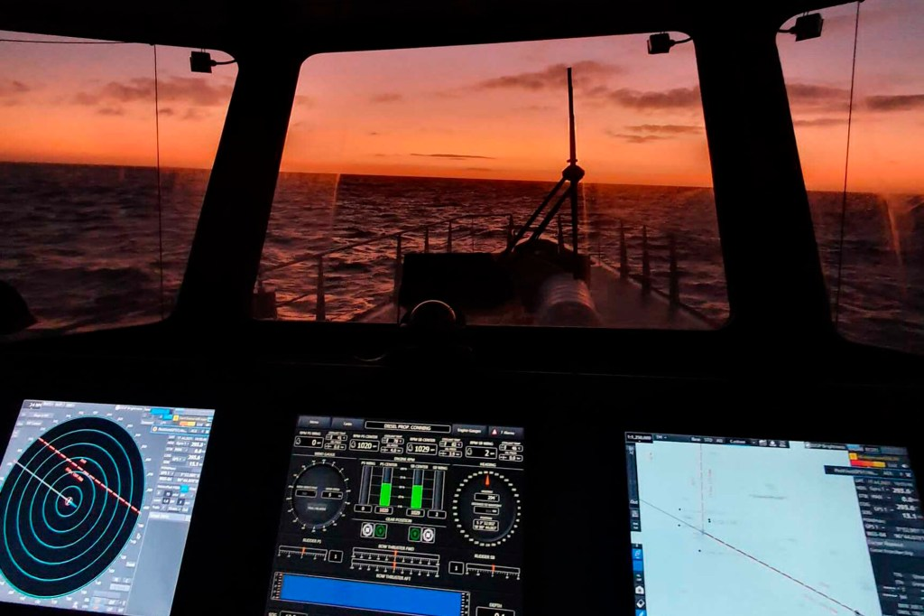 The view from the bridge of the Ocean Warrior at sunset.