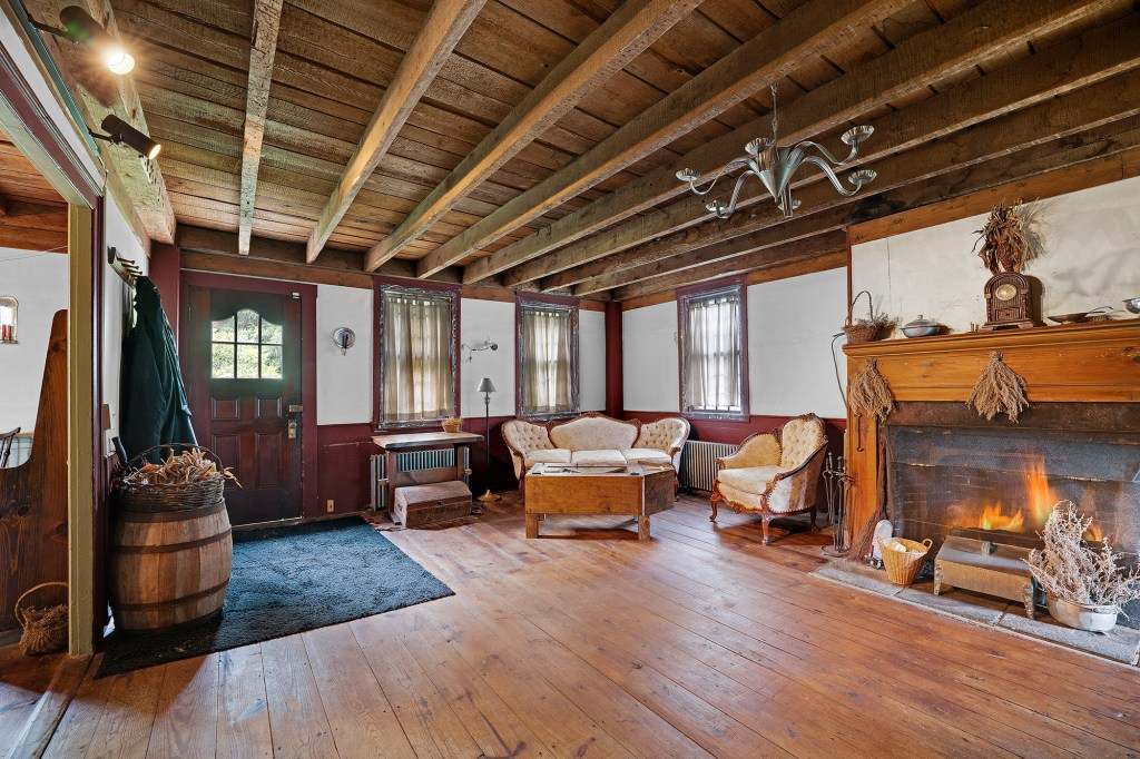 The 19th-century digs come with beamed ceilings and multiple fireplaces.
