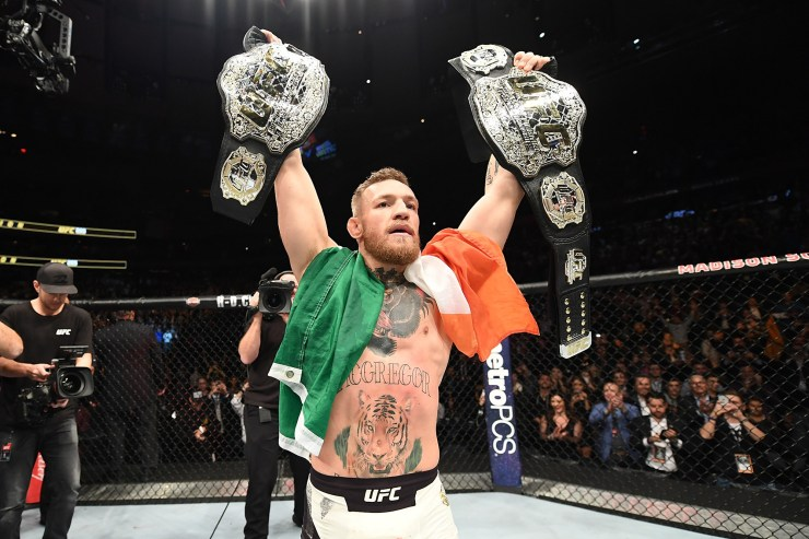 UFC lightweight and featherweight champion Conor McGregor celebrates after defeating Eddie Alvarez in their UFC lightweight championship fight during the UFC 205 event at Madison Square Garden on November 12, 2016 in New York City.