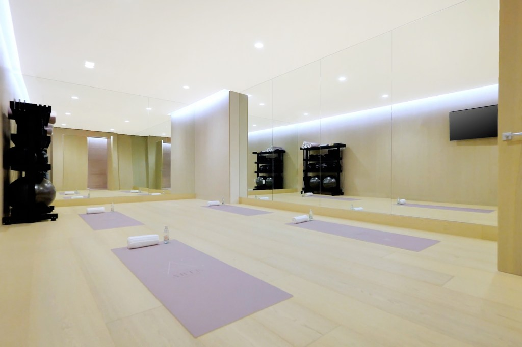 A yoga room as part of the building's amenities.