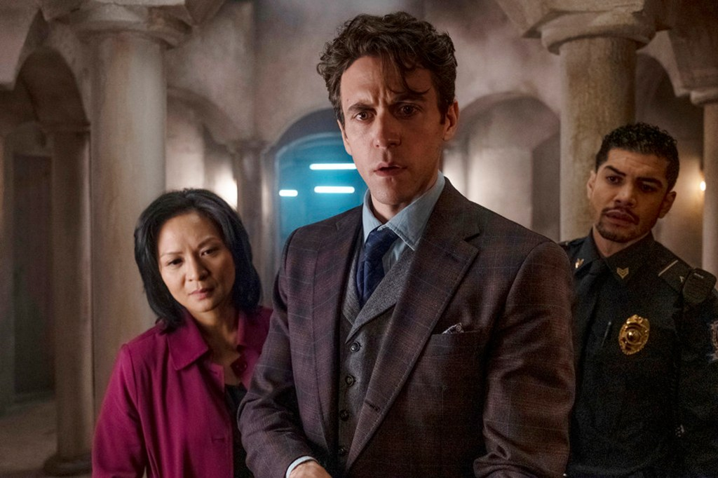 """Ashley Zukerman as Robert Langdon, center, with Sumalee Montano as Inoue Sato and Rick Gonzalez as Capital policeman Nunez, right, in """"The Lost Symbol."""""""
