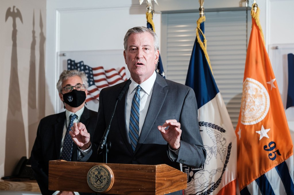 NYC mayor Bill de Blasio speaks at a press conference on Rikers Island after taking a tour of the facility.