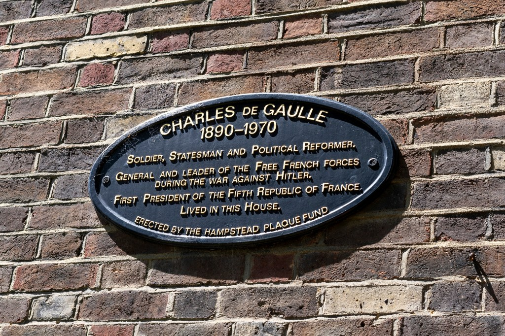 A plaque honoring Charles de Gaulle is placed against the estate.
