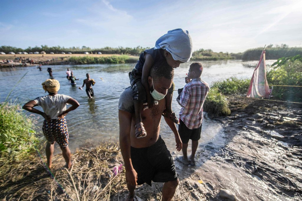 Haitian migrants cross the Rio Grande river to get food and water in Mexico.