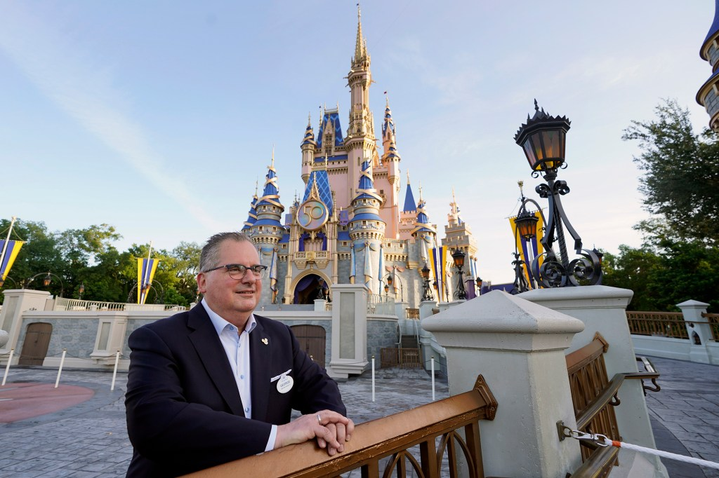 George Kalogridis, president of segment development and enrichment for Disney Parks, stands in front of the Cinderella Castle at the Magic Kingdom theme park at Walt Disney World Monday, Aug. 30, 2021, in Lake Buena Vista, Fla. Kalogridis was one of 6,000 employees that was working at the theme park on opening day in 1971.
