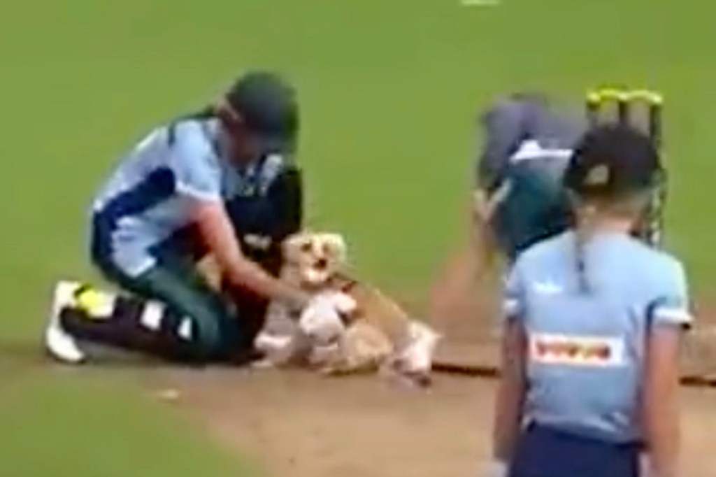 Players with the dog after it was finally caught.