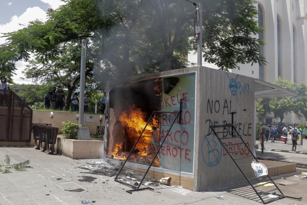 A bitcoin ATM burning in El Salvador