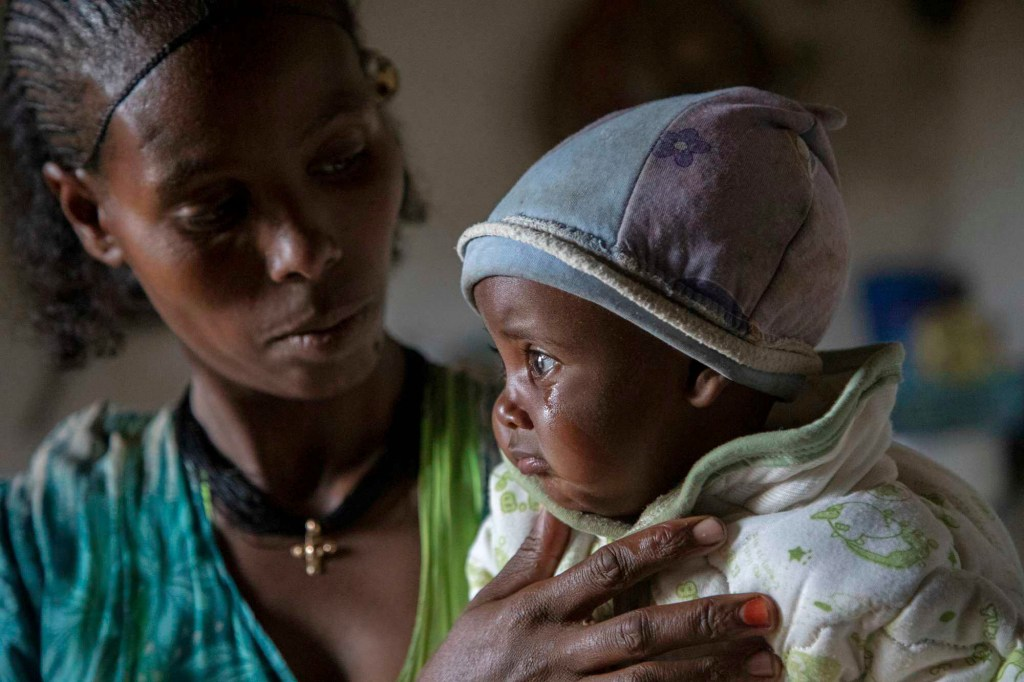 Mother Ababa, 25, comforts her baby Wegahta, 6 months, who was identified as severely acutely malnourished.