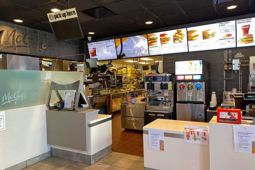 A McDonald's menu board and food ordering counter.