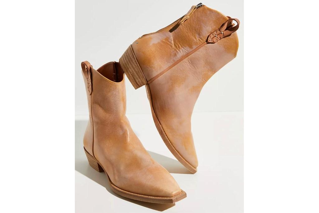 A pair of brown western style booties