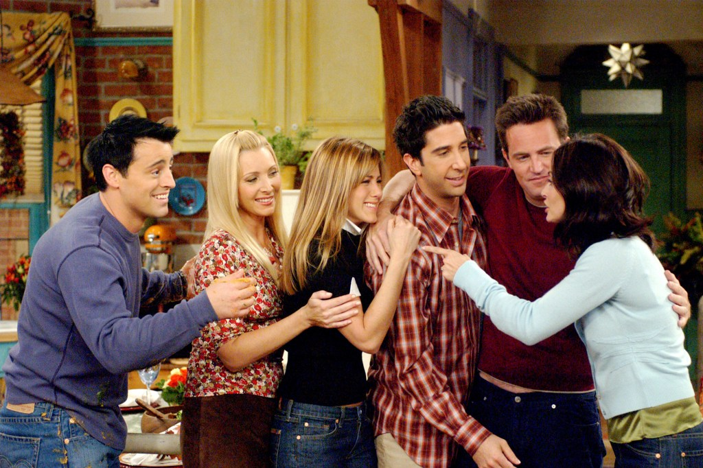 """From right: Joey (Matt Le Blanc), Phoebe (Lisa Kudrow), Rachel (Jennifer Aniston), Ross (David Schwimmer), Chandler (Matthew Perry) and Monica (Courteney Cox) in stand together toasting drinks in """"Friends."""""""