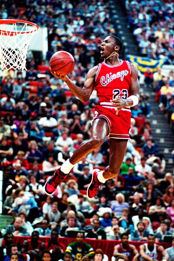 Michael Jordan debuts his Air Jordans in the 1985 slam dunk contest in Indianapolis.