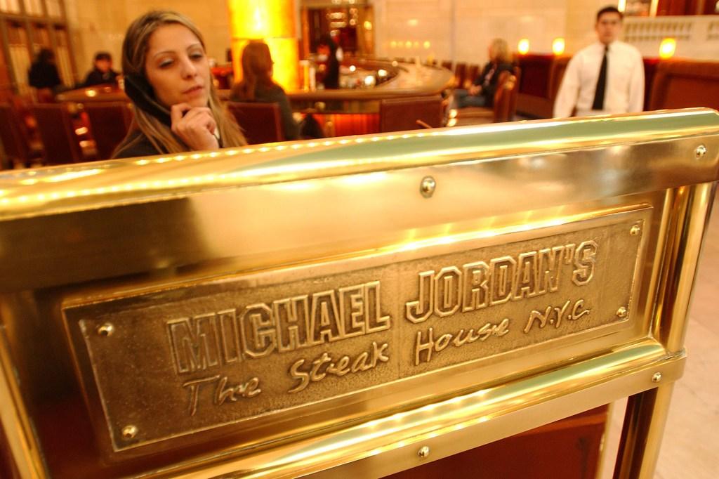 A hostess at Michael Jordan's Steak House answers a telephone call.