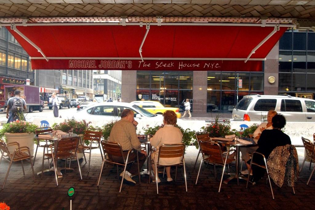 Diners sitting outside at Michael Jordan's Steak House.