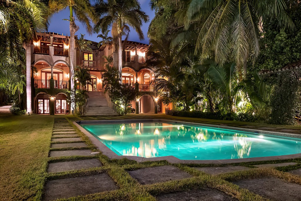The mansion's pool at night.